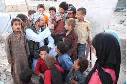 Guy Smallman with Afghan children. Picture taken by Guy's translator, who has since fled in fear of his life