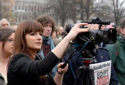 NUJ student member Julija Jegorova hones her filming skills at the Bristol & District Anti-Cuts Alliance demonstration in Bristol, February 2011. (Photo © Simon Chapman)