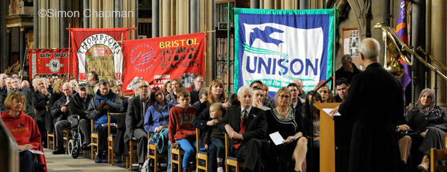 Canon Tim Higgins addresses the gathering at Workers Memorial Day, at Bristol Cathedral. (Photo © Simon Chapman)