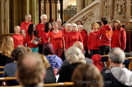The Red Notes Choir from Bristol sing at Workers Memorial Day, at Bristol Cathedral. (Photo © Simon Chapman)
