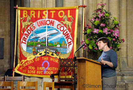 Anna McMullen from Labour behind the Label, addresses the gathering at Workers Memorial Day at Bristol Cathedral. (Photo © Simon Chapman)